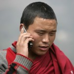 Bhutanese Monk on a Cell Phone