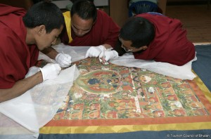 Thangkha restoration by Bhutanese monks