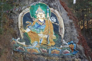 A painting of Guru Rimpoche on a rock