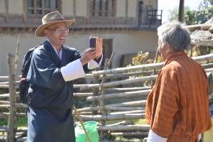 Prime Minister Tshering Tobgay takes a picture of a farmer during his country tour.
